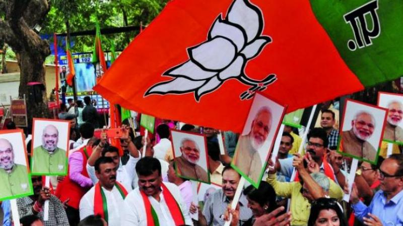 BJP workers celebrate the party's victory in the Gujarat and Himachal Pradesh Assembly elections, in Mumbai on Monday. (Photo: Debasish Dey)
