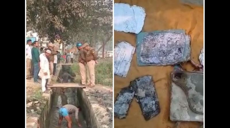 Sources said a purse, exam papers and some notes were among the things found from the drain located in the PS Kotwali area. (Photo: ANI)