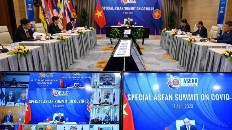 Vietnam's Prime Minister Nguyen Xuan Phuc (C) addresses a live video conference on the special Association of Southeast Asian Nations (ASEAN) Summit on the COVID-19 coronavirus pandemic in Hanoi on Tuesday. (AFP)
