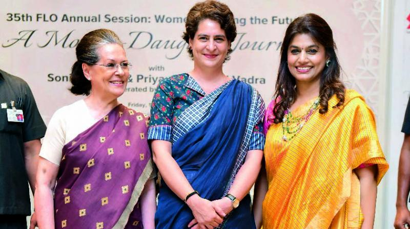 Sonia Gandhi and Priyanka Gandhi Vadra with Pinky Reddy, FLO's national president for 2018-19, who hosted and moderated the event.