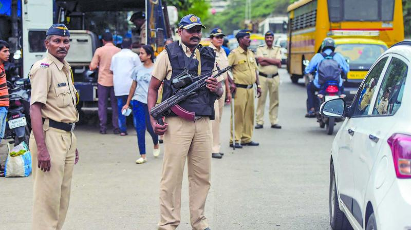 Police personnel maintain security in a street on the eve of Independence Day on Wednesday. (Photo: PTI)