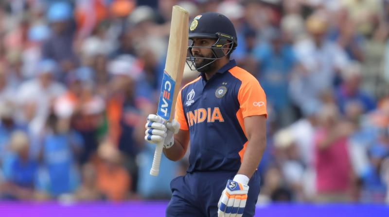 Rohit Sharma went on to score 102 runs against England. He was finally dismissed by Chris Woakes in the 37th over. (Photo:AFP)