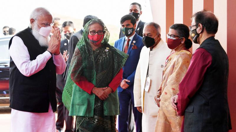 Prime Minister Narendra Modi being welcomed by Prime Minister of Bangladesh Sheikh Hasina and other dignitaries on his arrival at the National Day programme of Bangladesh, in Dhaka. (PTI)