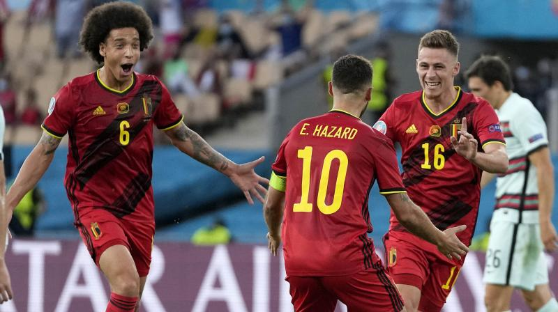 Belgium's  Axel Witsel (left) Eden Hazard (centre) and Thorgan Hazard celebrate after scoring their side's only goal in the Euro 2020 Round of 16 match between Belgium and Portugal in Seville on Sunday. (Photo: AP)