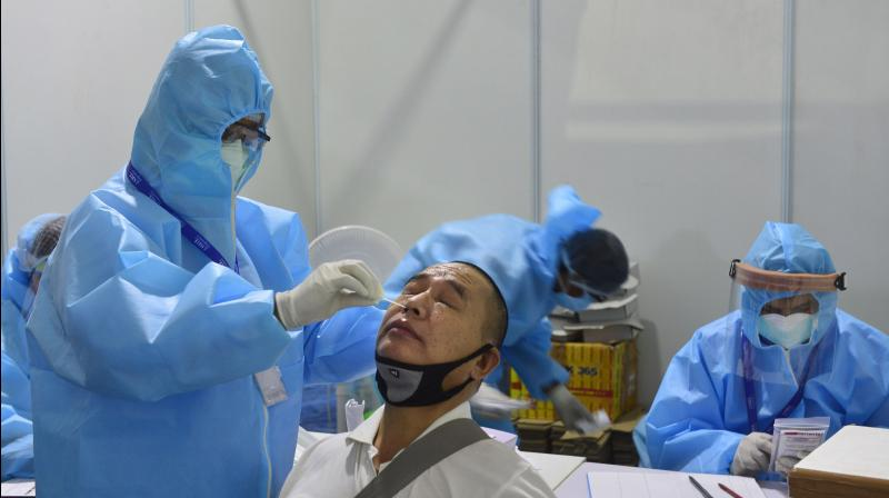 Health workers collect swab samples of people at Indo-Israel Non-Invasive Raid Covid -19 test study camp as part of Operation Open Skies, at Dr Ram Manohar Lohia Hospital in New Delhi. PTI photo
