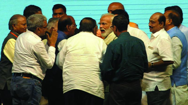 Prime Minister Narendra Modi talks to the traders during Traders Sammelan at Talkatora Stadium in New Delhi on Friday. 	(Photo: PRITAM BANDYOPADHYAY)