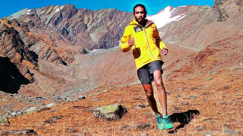 Ultra runner Kieren D'Souza on a little run at the base camp of Friendship Peak in the Pir Panjal range in Himachal Pradesh.