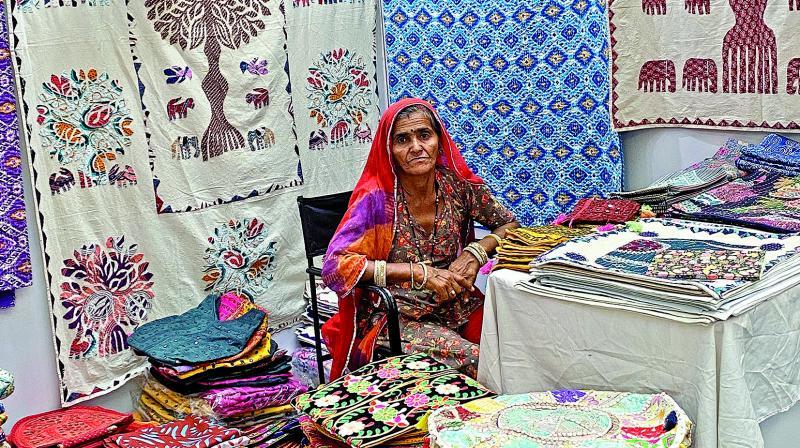 An artisian with her textile designs