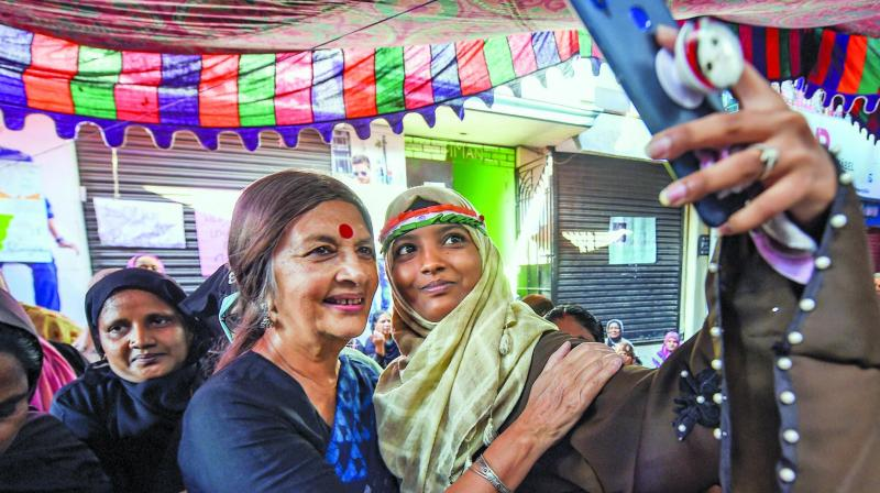 CPI(M) leader Brinda Karat poses for a selfie with  protestors demonstrating against the CAA at Old Washermanpet in Chennai on Thursday. (Photo: PTI)