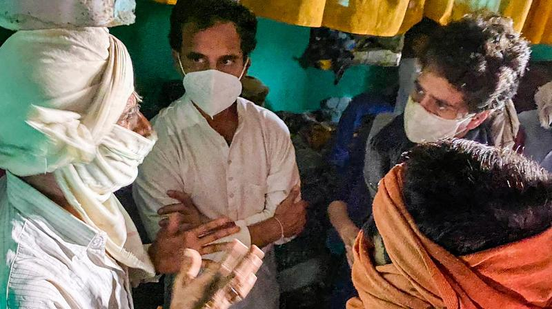 Congress leaders Priyanka Gandhi Vadra and Rahul Gandhi meet the family members of a 19-year-old Dalit woman who died after being allegedly raped two weeks ago, at Bulgadi village in Hathras. — PTI photo