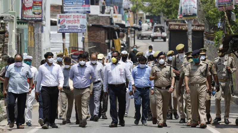 Health staff and policemen move into a coronavirus hotspot area in Allahabad to conduct testing for the coronavirus on Saturday, April 25, 2020. (AP)