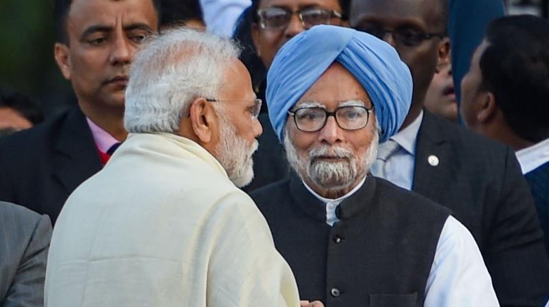 Former prime minister Manmohan Singh meets his successor Narendra Modi. (PTI)