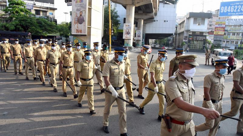 Kerala policemen conduct a march to enforce the COVID-19 lockdown in Kochi. The Kerala government has been forced by the Centre to step back on relaxations it had planned to give. (PTI)