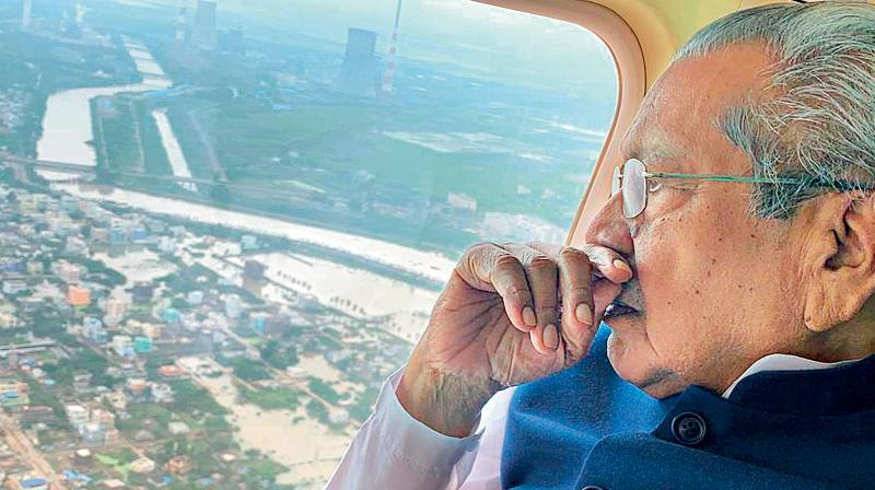 File photo of Andhra Pradesh governor Biswa Bhushan Harichandan making an aerial survey of flood-hit areas in the state. (DC Photo)
