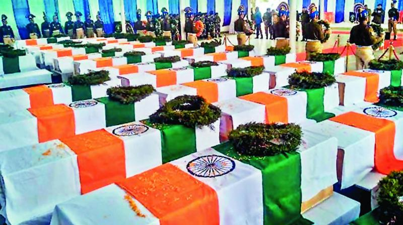 Coffins lie at the CRPF camp in Budgam on February 15                                 (Photo: PTI)