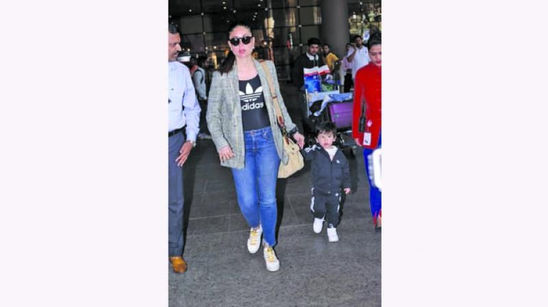 Kareena Kapoor Khan paired a sporty vest with denim and Taimur sporting tracksuit at the airport.