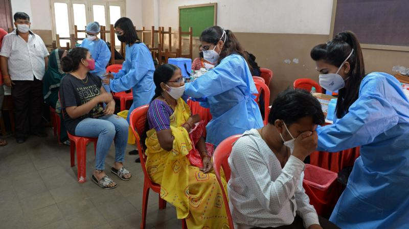 People get inoculated with the dose of the Covaxin Covid-19 coronavirus vaccine at a temporary vaccination camp inside a school in Mumbai. (Photo: AFP/File)