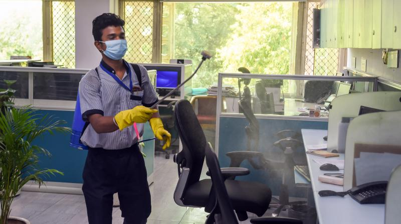 : A worker sanitizes inside Nirman Bhawan during Union Group of Ministers (GOM) meeting on COVID-19, amid the nationwide lockdown to curb the spread of coronavirus, in New Delhi. PTI Photo