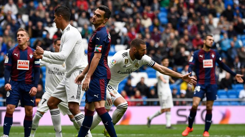 Benzema had an early strike disallowed at a barely half-full Santiago Bernabeu for offside and the visitors took a surprise lead in the 39th minute thanks to a cool finish from forward Marc Cardona, who is on loan from Barcelona. (Photo: AFP)