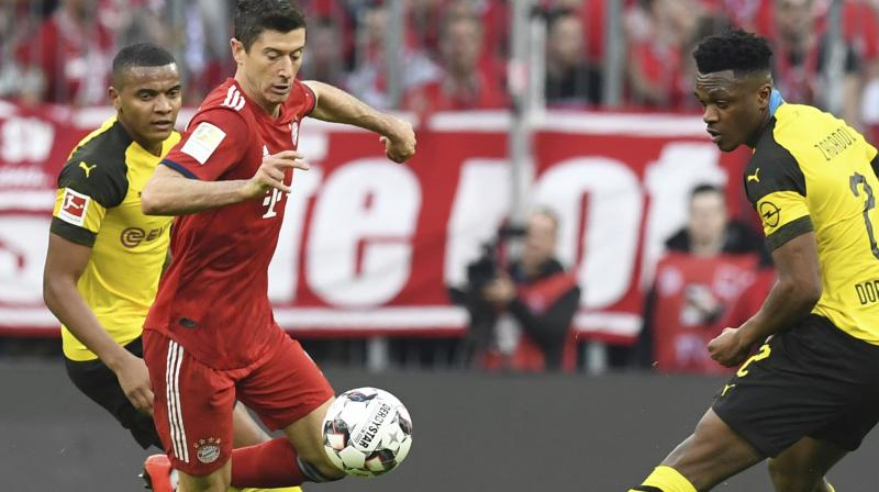 Lewandowski's strike meant the Polish forward became only the fifth player in Bundesliga history to reach the 200-goal mark and the first foreigner to do so. (Photo: AP)