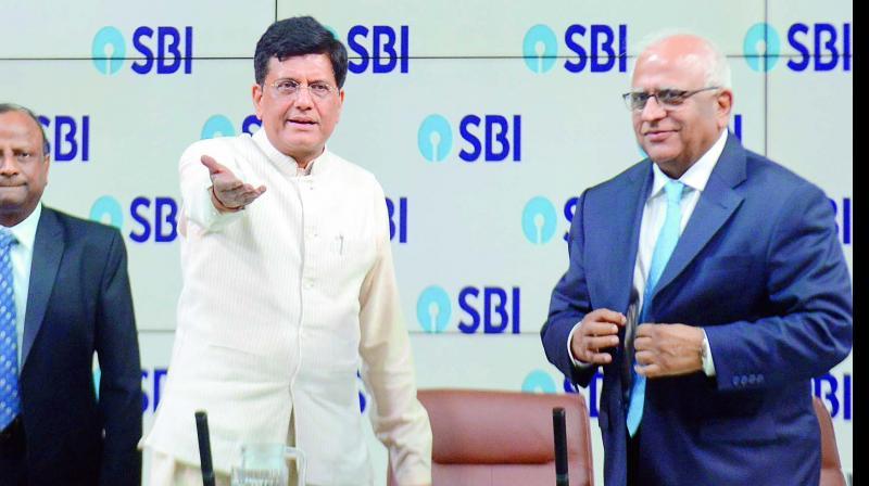 Union finance minister Piyush Goyal (centre) is seen along with SBI chairman Rajnish Kumar (left) and PNB chairman Sunil Mehta ahead of a press  conference organised by SBI in Mumbai on Friday. (Photo: Debasish Dey)