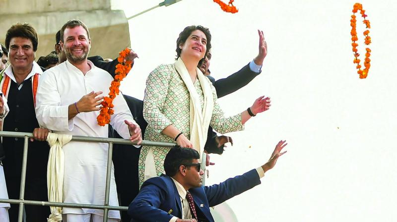 Congress president Rahul Gandhi with party general secretary Priyanka Gandhi Vadra and Uttar Pradesh Congress Committee president Raj Babbar during a roadshow in Lucknow on Monday. (Photo: PTI)