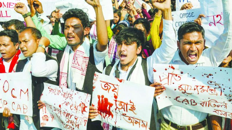 Students of Dibrugarh University stage a protest against Citizenship (Amendment) Bill in Dibrugarh on Monday. (Photo: PTI)