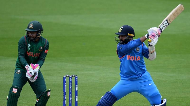 Dinesh Karthik, who got out for a duck in the first warm-up match against New Zealand, made full use of the opportunity in the second game as he tore apart the Bangladeshi attack in his 77-ball knock which was studded with 8 fours and a six.(Photo: AFP)
