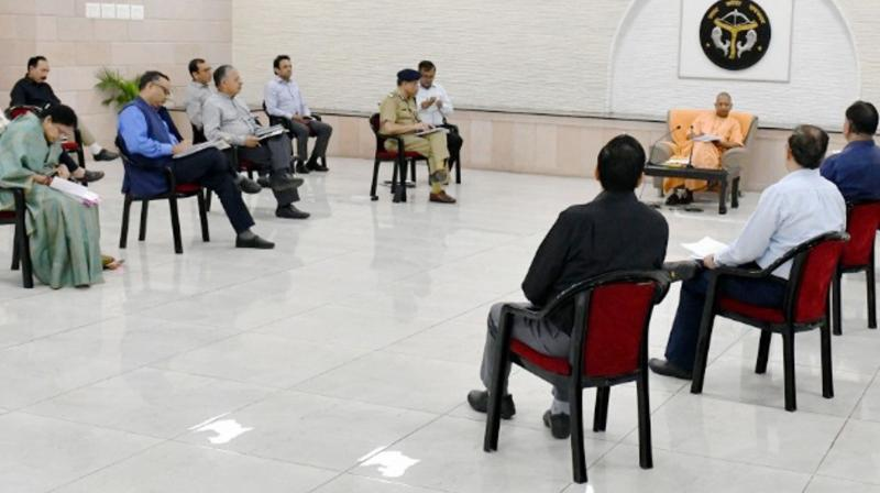 This is Uttar Pradesh chief minister Yogi Adityanath following social distancing while holding a meeting with his staff but before that he was all set to disregard national directives on avoiding mass meetings. (PTI)