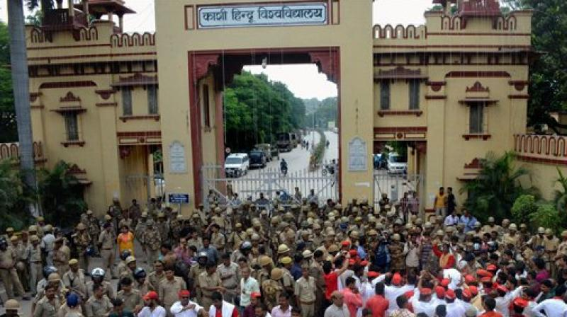 Heavy police force deployed outside the Banaras Hindu University as Samajwadi Party workers protest over the police laticharge on the female students of the university, in Varanasi. (Photo: PTI)