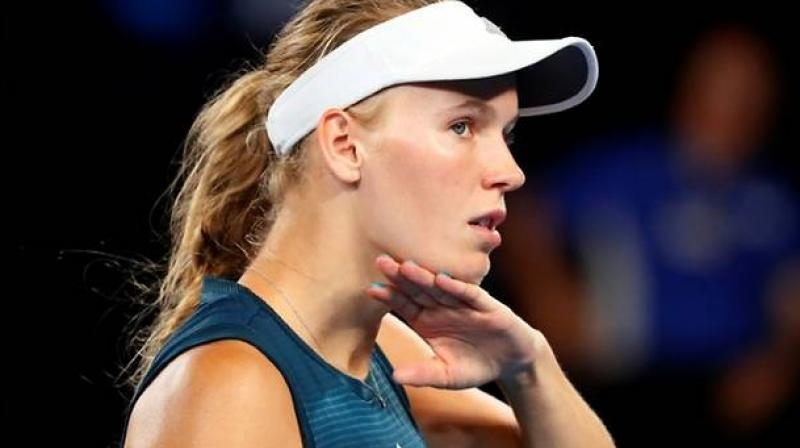 Former world number one Caroline Wozniacki on Tuesday pulled out of the Kooyong Classic citing soreness, meaning the Dane will have no further match practice before next week's Australian Open -- her final tournament before retiring. (Photo:AFP)