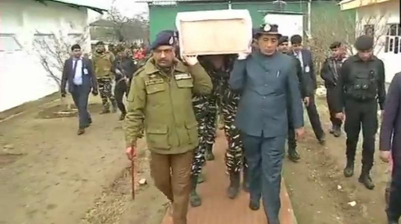 Union Ministers Rajnath Singh and J&K DGP Dilbagh Singh lend a shoulder to mortal remains of a CRPF soldier. (Photo: ANI | Twitter)