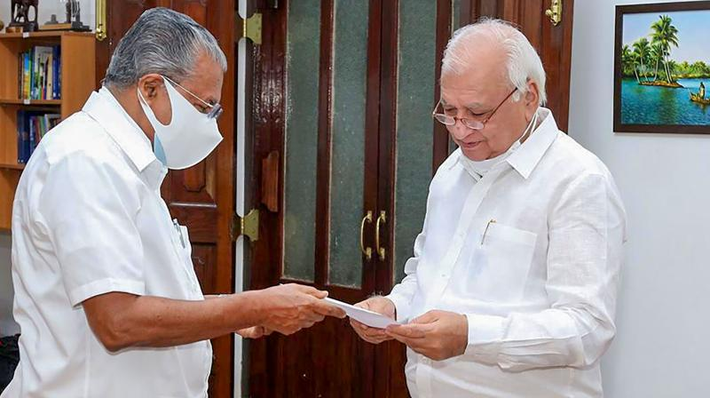 Kerala Chief Minister Pinarayi Vijayan with Governor Arif Mohammed Khan. (PTI)