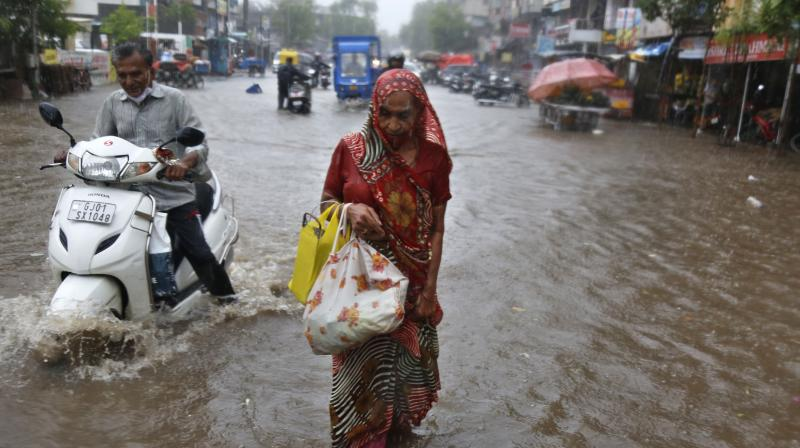 The IMD has issued a 'red alert' for Mumbai, and neighbouring Thane, Palghar and Raigad districts, warning of very heavy to extremely heavy rainfall at isolated places. — Representational image/AP