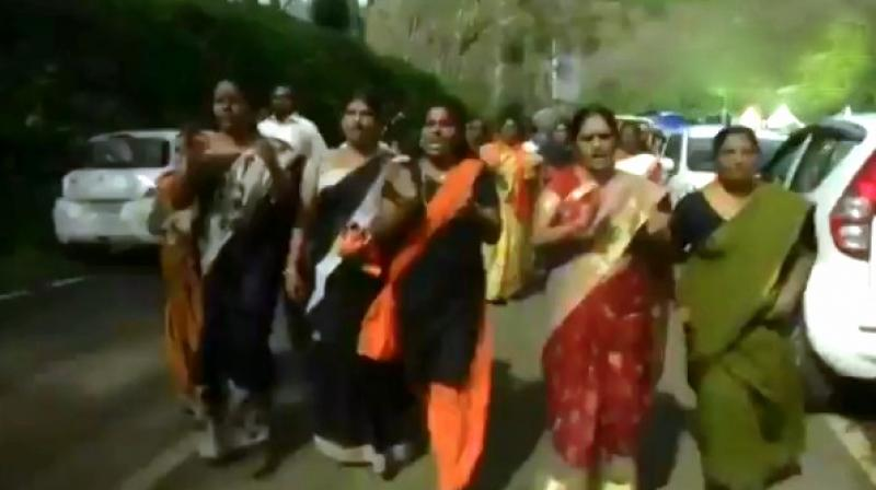 Slogans were raised as women marched in protest at Nilakkal, the main gateway to Sabarimala. (Screengrab | ANI)