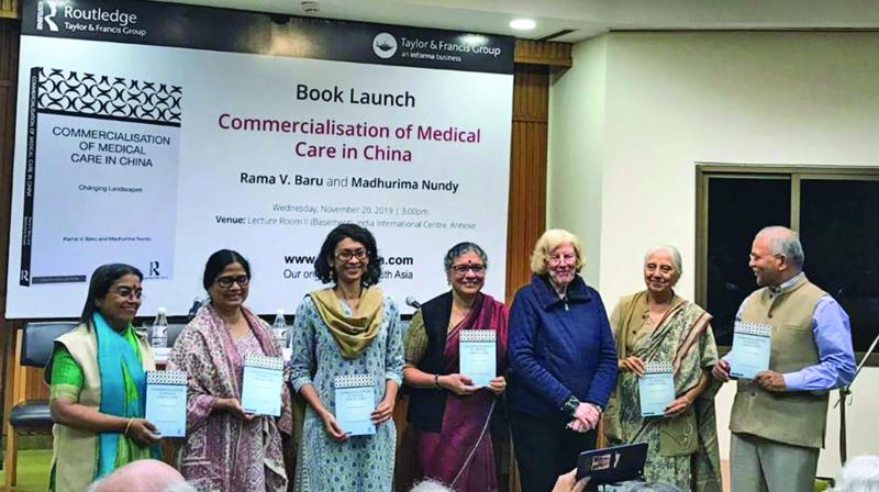 Madhurima Nundy (3rd from left) and Rama V. Baru (4th) at the launch of their book at India International Centre Annexe in New Delhi.