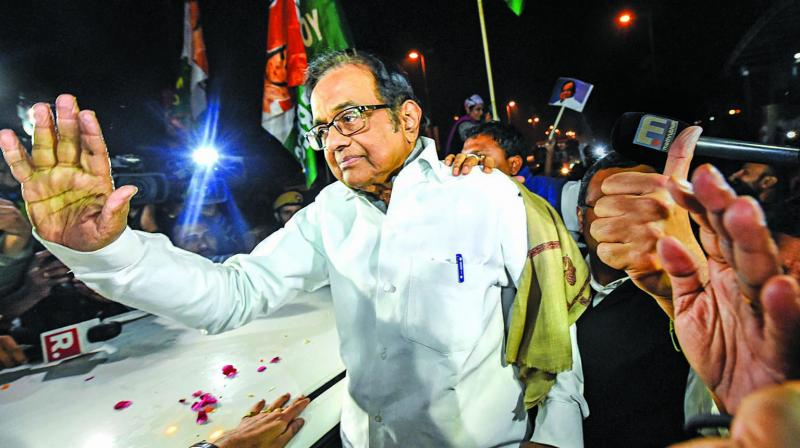 Senior Congress leader P. Chidambaram waves at Congress workers and supporters after he was released from Tihar Jail in New Delhi. (Photo: PTI)