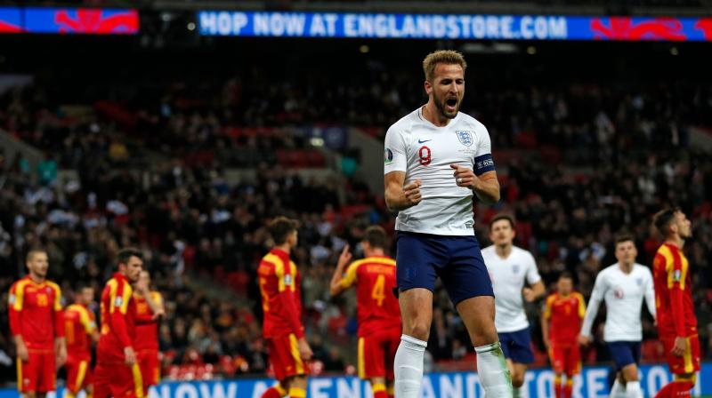 Harry Kane scored a first half hat-trick as England booked their place in the finals of Euro 2020 as group winners with a crushing 7-0 victory over Montenegro at Wembley Stadium on Thursday. (Photo:AFP)