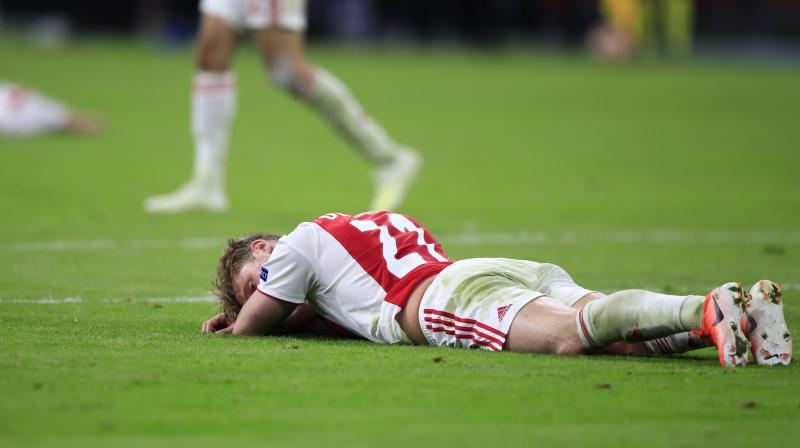Many newspapers used the same language to describe the 'buttock-clenching' tension as Ajax let their lead slip away. (Photo: AP)