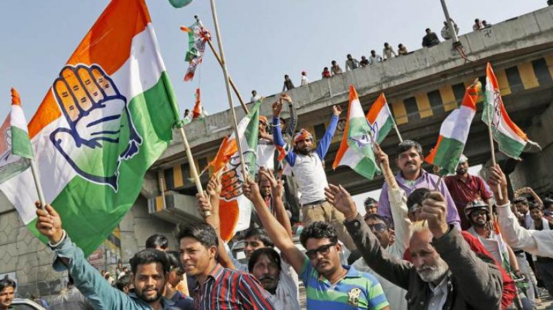 Congress workers celebrate victory in state assembly elections. (Photo: PTI)