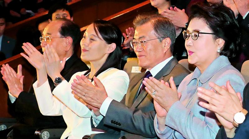South Korean President Moon Jae-in, second from right, applauds with Kim Yo-jong, third from right, North Korean leader Kim Jong Un's sister, during a performance of North Korea's Samjiyon Orchestra at National Theatre in Seoul on Sunday.