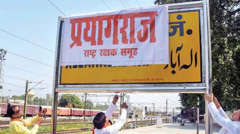 Protesters cover a nameplate of Allahabad with Prayagraj. — File