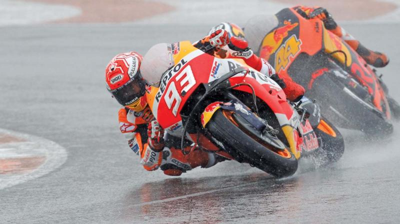 Honda rider Marc Marquez leads KTM's Pol Espargaro during the Motorcycle Grand Prix at the Ricardo Tormo circuit in Cheste near Valencia on Sunday. (Photo: AP)