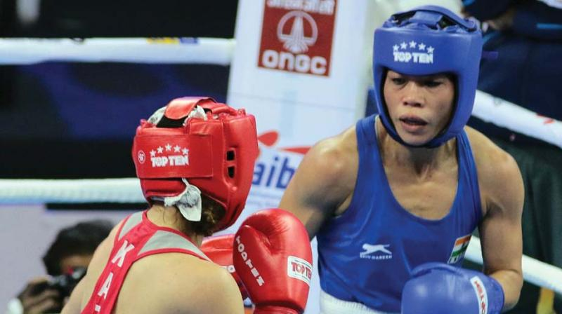 Mary Kom (left) in action against Kazakhstan's Aigerim Kassenayeva in their world championship pre-quarterfinal bout in New Delhi on Sunday.