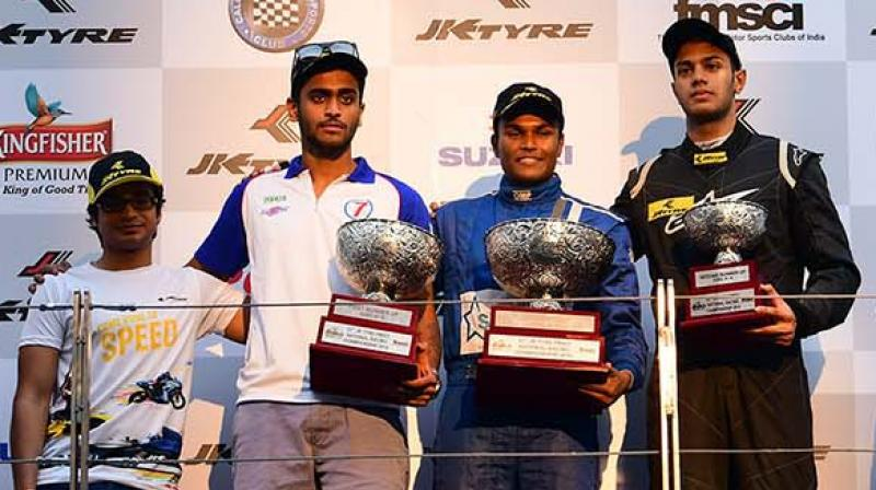 Champion Karthik Tharani (centre) is flanked by runner-up Nayan Chatterjee (second from left) and Ashwin Datta at the 21st edition of the JK Tyre FMSCI National Racing Championship at the Buddh International Circuit on Sunday.