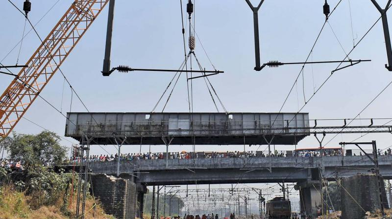 The two-lane bridge was torn into two using cranes after disconnecting the overhead wires located below the structure. The bridge had two 27-metre-long steel spans weighing approximately 60 tonnes.