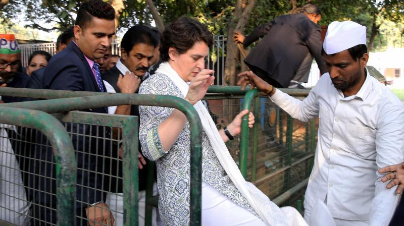 AICC General Secretary Priyanka Gandhi Vadra along with party workers during a peace march against the communal violence in North-East Delhi area. PTI