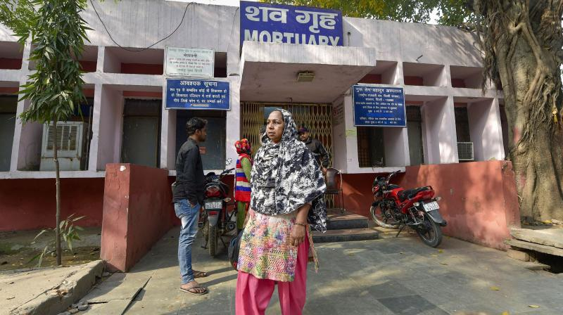 Tahira Begum from Mustafabad waits outside the mortuary of GTB hospital to receive the body of her sister Mehtab (22), who was killed during communal violence in  northeast Delhi area over the amended citizenship law, in New Delhi