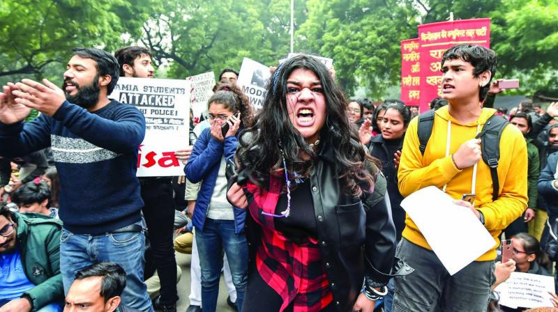 Anti-CAA protesters hold placards and shout slogans at Jantar Mantar in New Delhi on Thursday. (Photo: PTI)