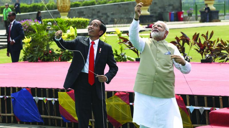 Prime Minister Narendra Modi flies kites with Indonesian President Joko Widodo during the India-Indonesia kite exhibition in Jakarta. (Photo: AP)